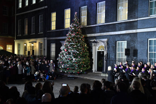 Carol singers sing outside No. 10 Downing Street in London England