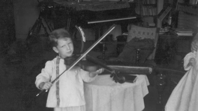 André Rieu playing a full-size violin as a child
