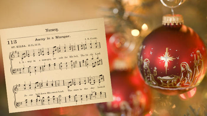 What are the lyrics to 'Away in a Manger', and where does the carol come from?