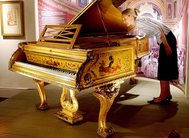 Queen Elizabeth II's 1854 grand piano, made for Queen Victoria by Erard of London, at Buckingham Palace in London.