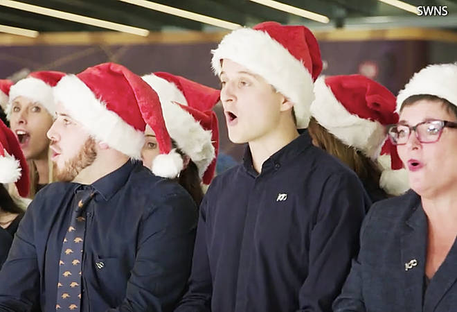 The crew sang 'Deck the Halls' to surprised onlookers in Terminal 5