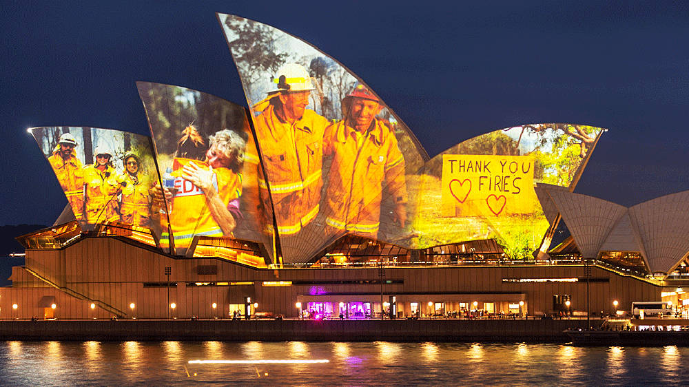Heroic bushfire firefighters honoured by Sydney Opera House as their photographs illuminate its façade