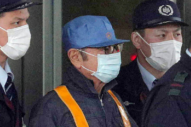 Carlos Ghosn was pictured leaving prison disguised as a workman in March 2019