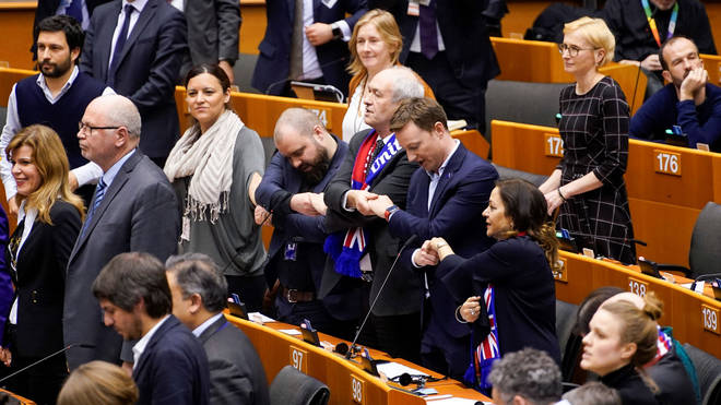 MEPs hold hands after European Parliament vote in Brussels on January 29, 2020