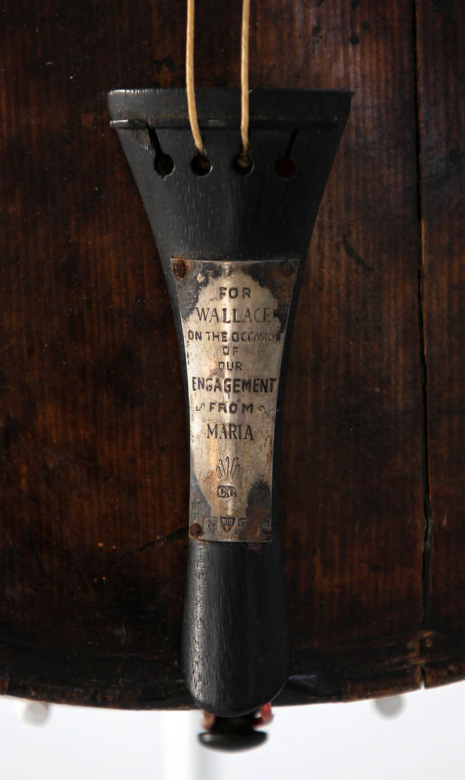 The instrument bears an engraved message from the musician's fiancé that reads: 'For Wallace, on the occasion of our engagement. From Maria.'