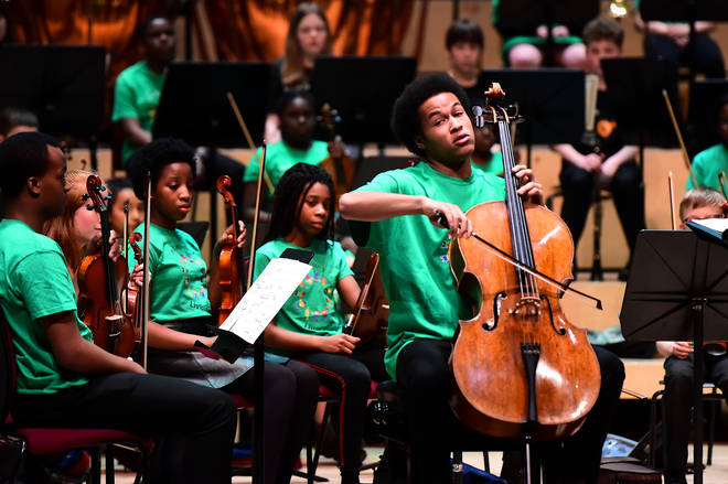 Sheku Kanneh-Mason performs on stage at the In Harmony 10th Anniversary Concert at the Philharmonic Hall