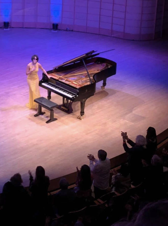 Yuja Wang, in sunglasses, pictured smiling at audience