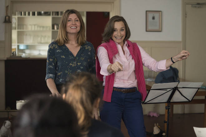 Kristin Scott Thomas (right) stars in Military Wives alongside Sharon Horgan