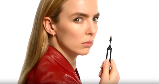 Jodie Comer as Villanelle in the 'Killing Eve' Season 3 trailer holding a tuning fork