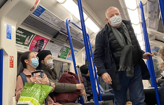 London tube users wear masks as total number of coronavirus cases grow in the UK