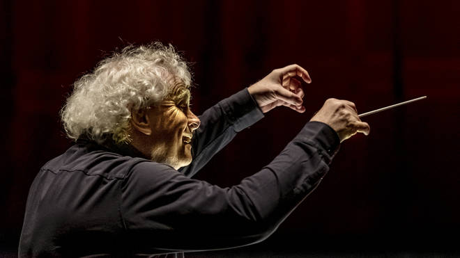Conductor Simon Rattle recently conducted the Berlin Philharmonic in their free live stream of Berio and Bartók.