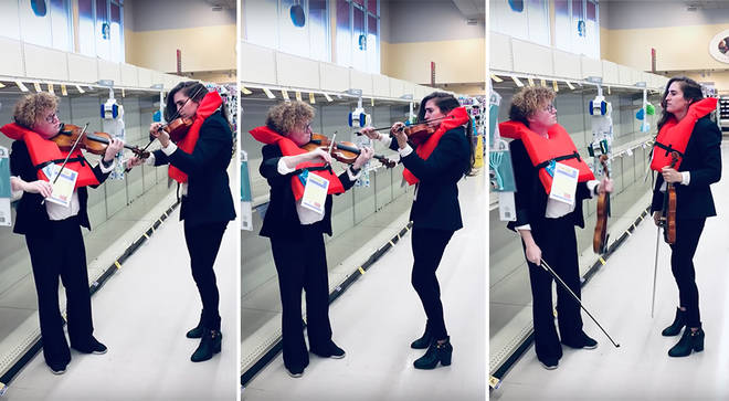 Violinists serenade shoppers in empty toilet paper aisle with 'Titanic' hymn