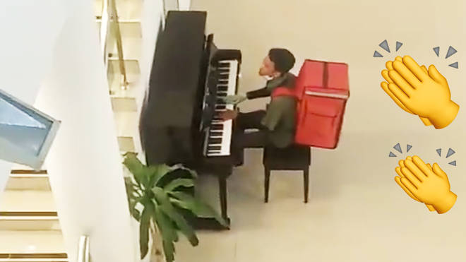Food delivery cyclist impresses locals with piano skills