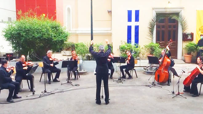 Greek orchestra performs musical tribute for frontline workers in hospital courtyard