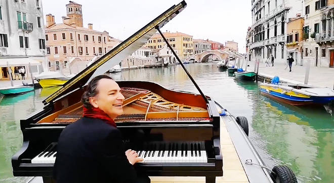 A pianist took his grand piano on a barge, to serenade the canals of Venice