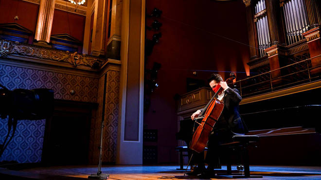 Cellist Václav Petr is pictured in the Rudolfinum in Prague, performing at a benefit concert 'without an audience' hosted by the Czech Philharmonic
