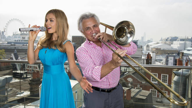 John Suchet accompanies Katherine Jenkins on the trombone.