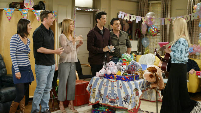 The cast of Friends enjoy a birthday song from Phoebe