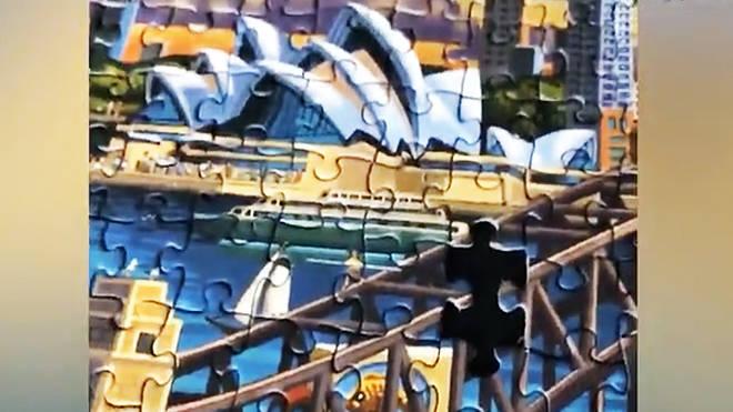 Hugh Jackman builds Sydney Opera House jigsaw puzzle
