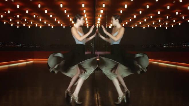Dancer Alizée Sicre assemblés, grande jetés and pirouettes through the empty Komische Opera in this stunning video