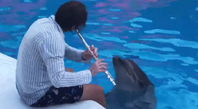 Russian flautist Maxim Rubtsov plays the flute for dolphins