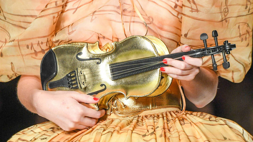 A high fashion brand is selling the most extra violin handbag, and it's a lot.