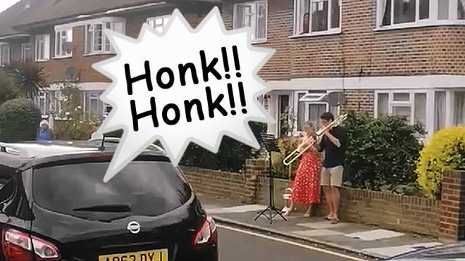 Couple's neighbourhood brass duet turns into waltz trio, as car horn joins in