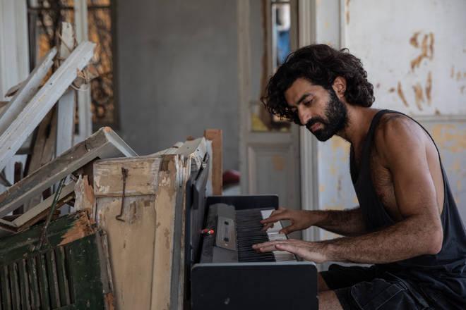 Essayan plays his artwork