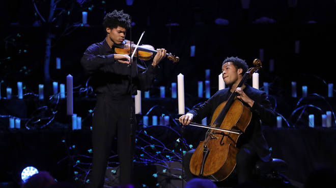 Cellist Sheku Kanneh-Mason performs with his older brother, violinist Braimah for Holocaust Memorial Day Commemorative Ceremony at Methodist Central Hall in London.