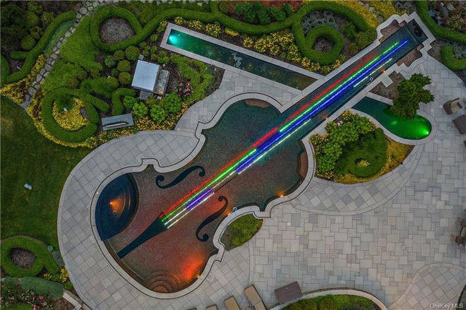 The violin-shaped pool took 15 months to complete