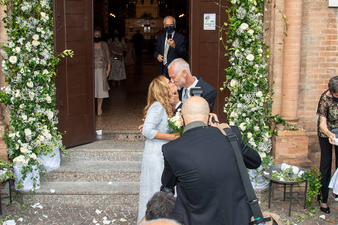 The happy couple after their wedding at Sant Antonio da Padova Basilic in Bologna