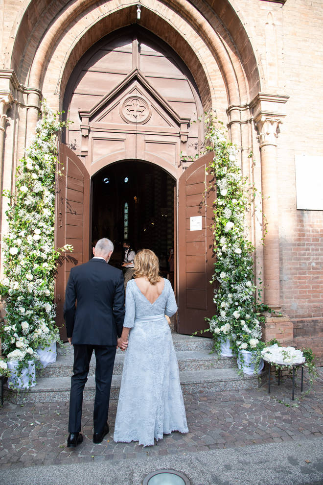Nicoletta Mantovani and Alberto Tinarelli enter the church for the ceremony