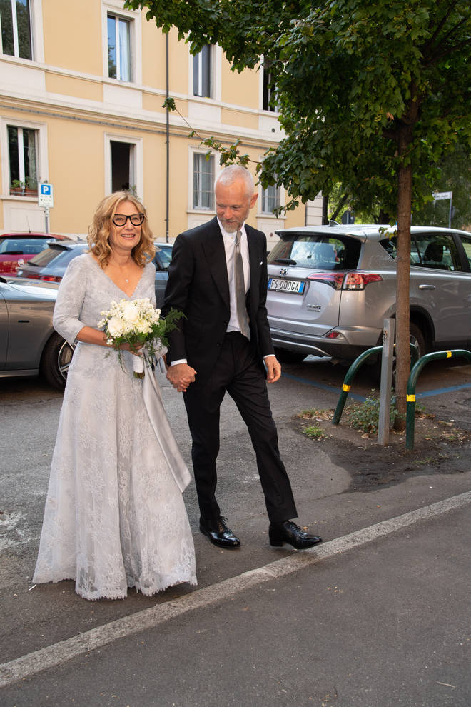 Nicoletta Mantovani and Alberto Tinarelli arrive at their wedding