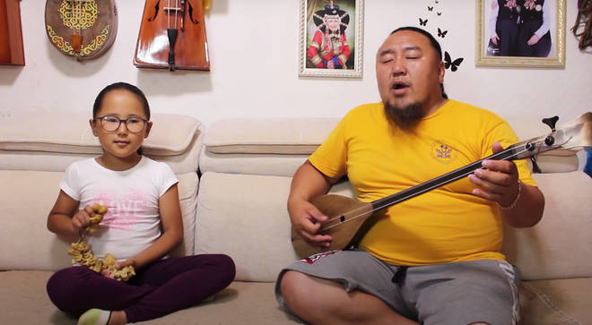 Dad and daughter's Mongolian throat singing duet