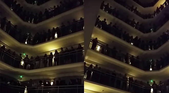 Amazing high school students sing 'Down to the River to Pray' from hotel balconies