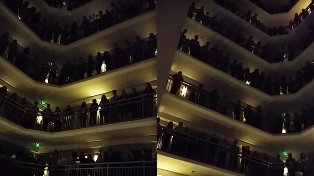 Amazing high school choir sings 'Down to the River to Pray' from hotel balconies