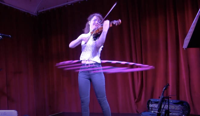 Violinist plays Paganini while hula-hooping