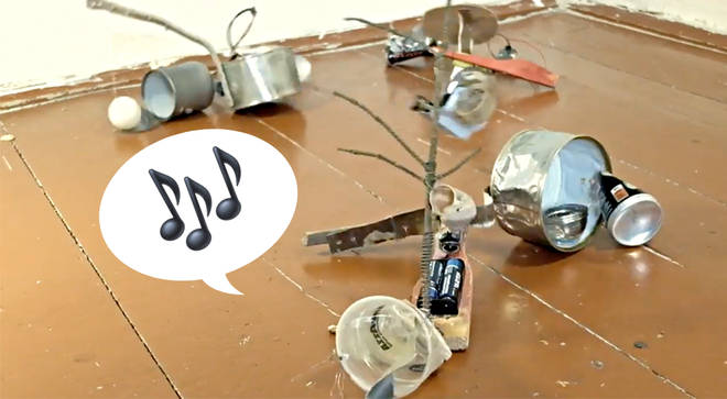 Someone attached motors to piles of garbage and created a percussion nightmare