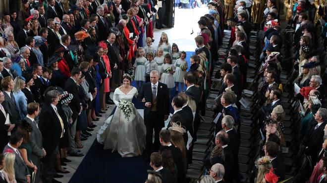 Princess Eugenie walks down the aisle