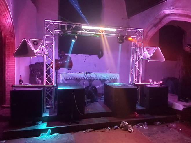 Rave organisers set up DJ decks in the church