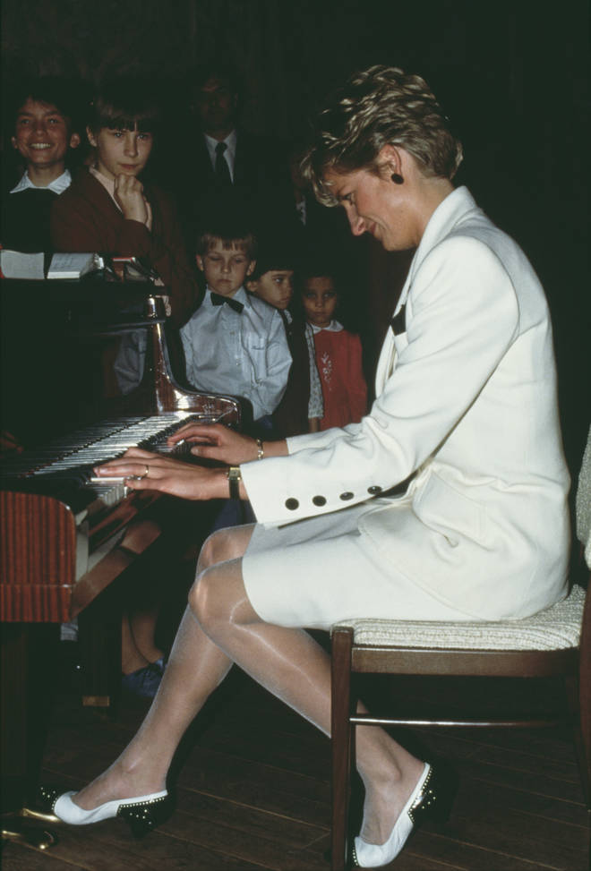 Diana, Princess of Wales plays piano during a 1991 tour in Prague