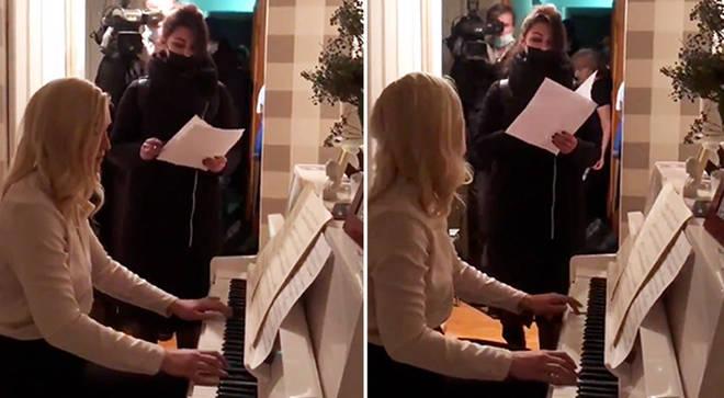 Anastasia Vasilyeva plays piano as police raid her Moscow flat