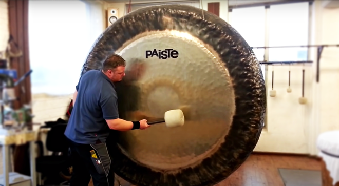Man plays a mighty 80-inch symphonic gong