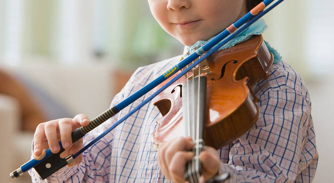 Russian mother taken to court as 9-year-old boy's violin playing 'breaks local noise laws'