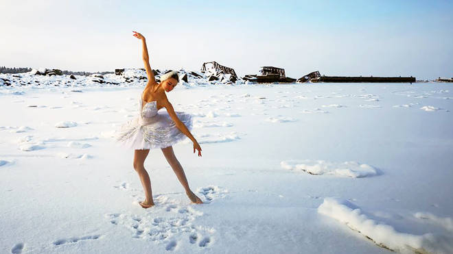 Breathtaking moment a Russian ballerina dances real 'Swan Lake' on ice