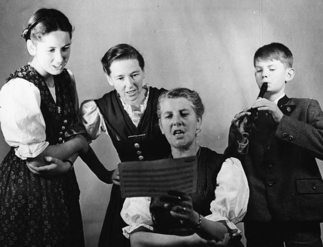 Baroness Maria von Trapp sings with some of her children