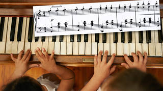What is Chopsticks? Two girls play on piano