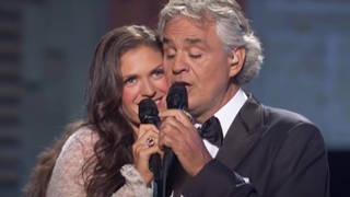 Andrea Bocelli and his wife Veronica Berti sing a tender duet of 'Cheek to Cheek'