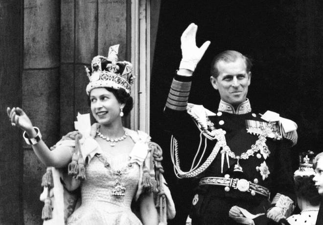Queen Elizabeth II and the Duke of Edinburgh wave from the balcony to crowds around Buckingham Palace after the Coronation