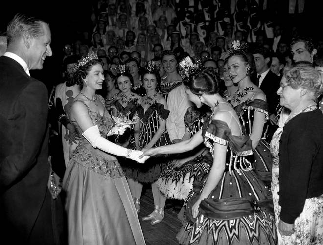 1958: The Queen and Duke of Edinburgh meet a member of the Royal Ballet after the gala performance in celebration of the centenary of the Royal Opera House, Covent Garden.